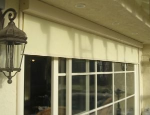 Drop-roll cover on a sliding glass door