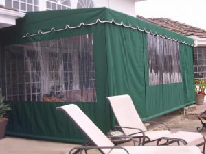 Dark green patio shade awning with clear plastic panels