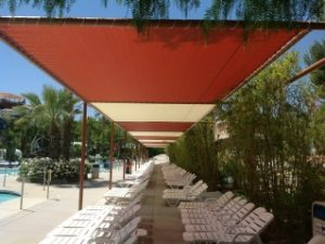 Custom pool awning with red and white fabric