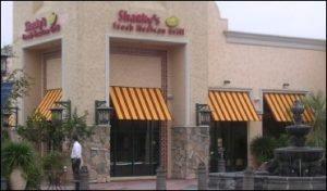 Shacky's red and yellow custom window canopy