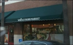 Green custom storefront awnings for Whole Food Market