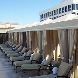 Pool cabanas and drapes with light colored fabric