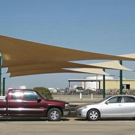 Custom sail panel offering shade in a parking lot