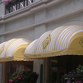 Custom storefront awning with white and gold fabric