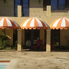 Striped pool awning with white and orange fabric