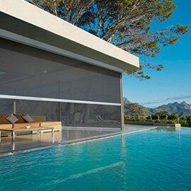 Custom retractable pool shade with dark fabric