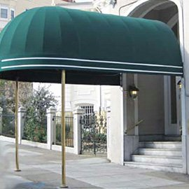 Custom entrance awning with green fabric and gold accents