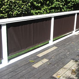 Dark fabric covers for a deck