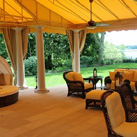 Beautiful metal awning with yellow fabric over an outdoor patio