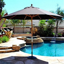 Van Nuys umbrella offering shade next to a beautiful pool