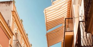 Stripped orange and white custom retractable awnings