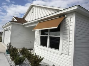 Light brown awning fabric on a Sol-Lux smart awning window cover