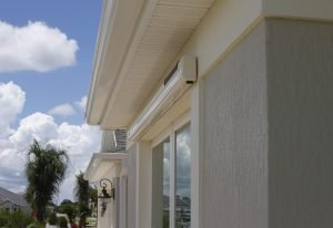 Retracted Sol-Lux smart awning on a grey colored home