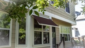 Sol-Lux smart awning window cover with maroon awning fabric