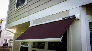 Maroon awning fabric on a Sol-Lux smart awning window cover