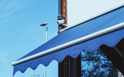 blue awning over a business window